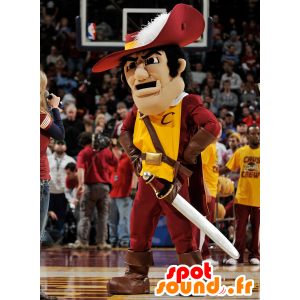 Musketeer mascot in traditional red and yellow outfit