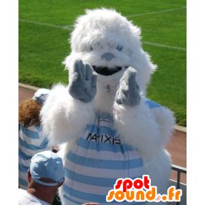 Mascot white and blue yeti, while hairy