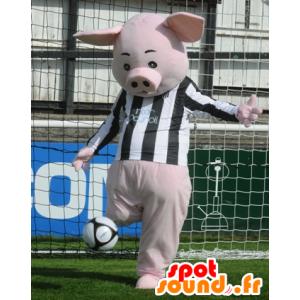 Mascotte de cochon rose avec un maillot noir et blanc