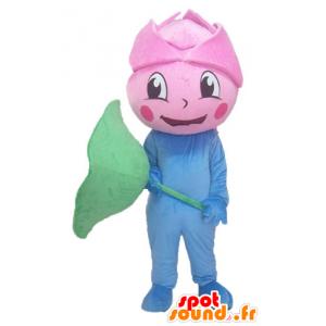 Mascota gigante de color rosa, flor rosada, azul y verde