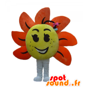La mascota de la flor gigante, amarillo y naranja