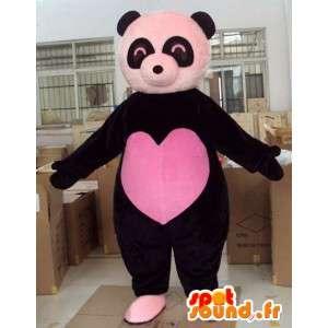 Maskot černého medvěda s velkým růžovým srdcem plným lásky ve středu