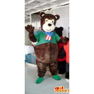 Mascot teddy bear brown with his shirt green