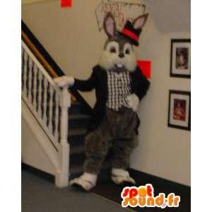 Mascotte de lapin gris et blanc habillé en smoking