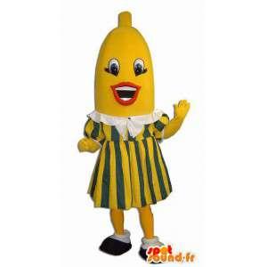 Mascote banana gigante vestida no vestido amarelo e verde