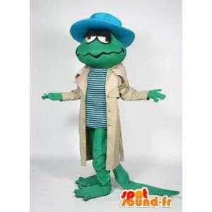 Groene hagedis mascotte met een jas en een blauwe hoed