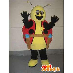Mascotte de coccinelle jaune et rouge habillée en cow-boy