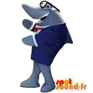 Mascota del tiburón gris en traje azul con gafas