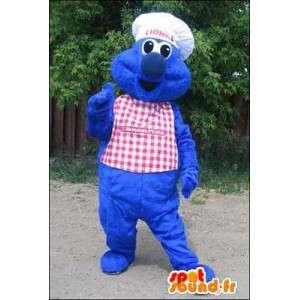 Mascotte de monstre bleu en chef cuisinier. Costume de chef