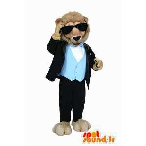 Mascotte de lion en costume, avec des lunettes noires