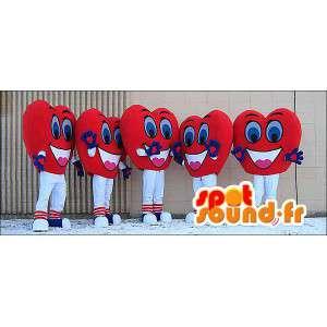 Maskoter av röda och leende hjärtan. Förpackning med 5 -