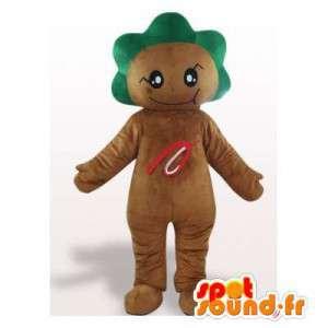 Brun cookie maskot med grønt hår