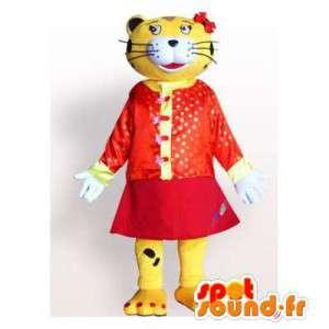 Żółty i czarny tygrys maskotka ubrana w czerwoną sukienkę