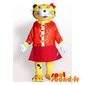 Geel en zwart tijger mascotte, gekleed in rode jurk