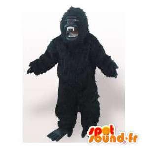 Maskot realistické černé gorila. černá gorila oblek