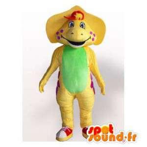 Mascot dinosaurio amarillo y verde con guisantes rojos