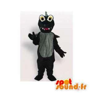 Maskotti musta dinosaurus. musta puku
