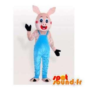 Piccola mascotte maiale rosa in tuta blu