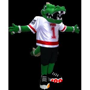 Groene krokodil mascotte gekleed in het voetbal