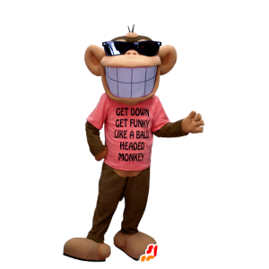 Brown and beige monkey mascot, with a broad smile