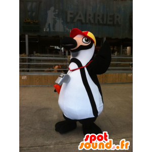 Black and white penguin mascot with a cap
