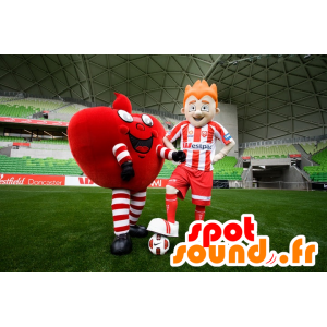 2 mascots, a giant red heart, and a footballer - MASFR20463 - Valentine mascot