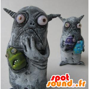2 mascottes kleine grijze monsters