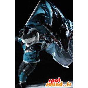 Mascotte de requin gris et blanc, en tenue de sport