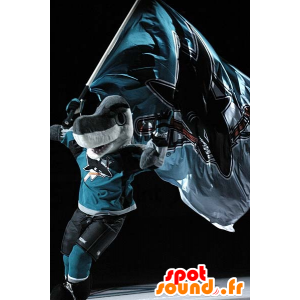 Maskotka szary i biały rekin w sportowej