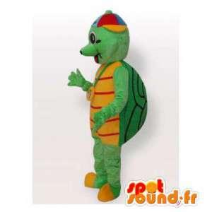 Mascote tartaruga verde e amarelo com um chapéu colorido