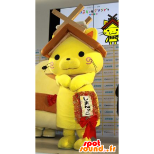 Mascotte de chat jaune avec un toit de maison sur la tête