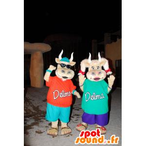 2 μασκότ χαριτωμένο και πολύχρωμο αγελάδες
