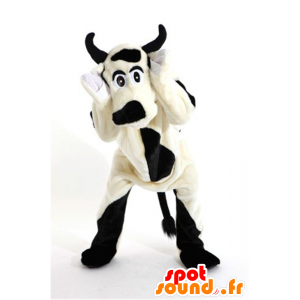 Mascot black and white cow, dog