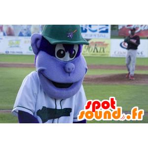 Mascota mono púrpura, con una gorra