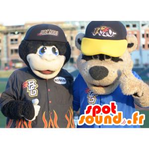 2 mascottes: un singe noir et un ours marron