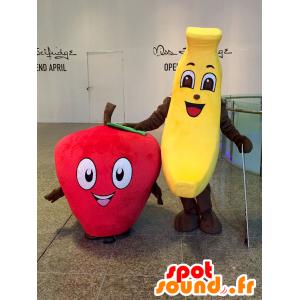 2 mascottes: une banane jaune et une fraise rouge