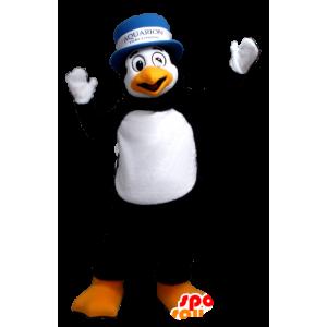 Mascotte de pingouin noir et blanc, avec un chapeau