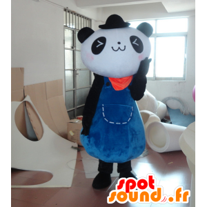La mascota de la panda blanco y negro en un vestido azul