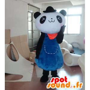Mascot panda preto e branco em um vestido azul