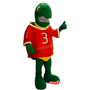 La mascota de la tortuga verde y amarillo, muy sonriente