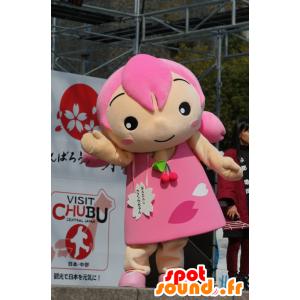 Mascot jente med hår og en rosa kjole