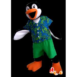 Μασκότ πιγκουίνος μαύρο, λευκό και πορτοκαλί με μια πολύχρωμη στολή