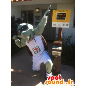 La mascota de la tortuga verde y marrón con gafas de aviador