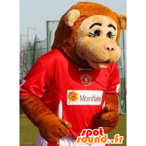 Beige ape maskot og oransje i sportsklær