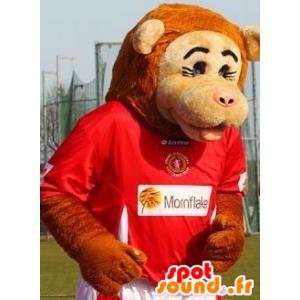 Mascotte de singe beige et orange en tenue de sport