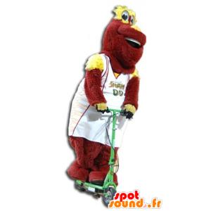 Mascotte de peluche rouge et jaune, en tenue de sport