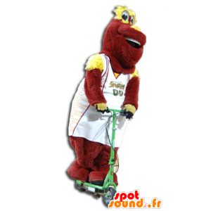 Red and yellow plush mascot in sportswear