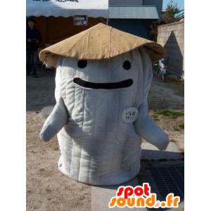 Mascotte en forme de hutte blanche et marron, géante et souriante