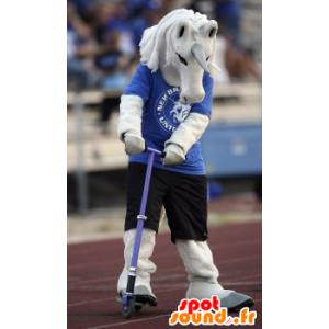 Blanca mascota unicornio en traje azul y negro