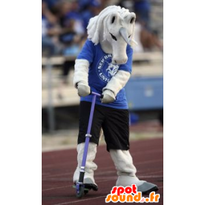 White unicorn mascot in blue and black outfit